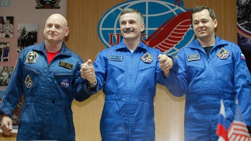 From left: US astronaut Scott Kelly, Russian cosmonauts Alexander Kalery and Oleg Skripochka, crew members of the mission to the International Space Station, ISS, pose after a news conference at the Russian leased Baikonur cosmodrome, Kazakhstan.