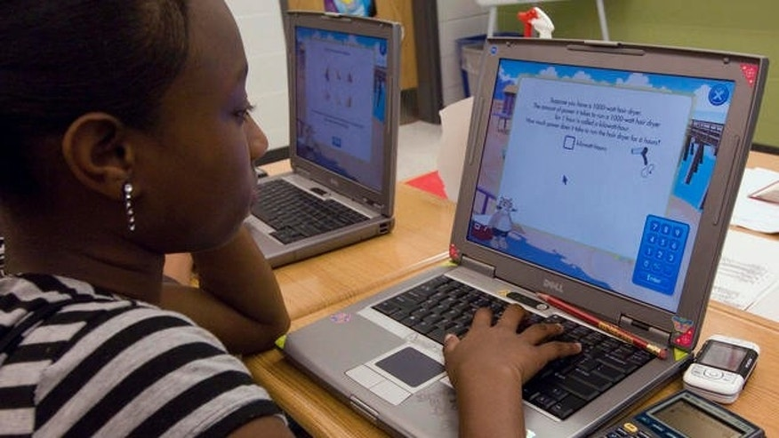 Destinee Brown, 14, and eighth grade student, works on her computer during math class at the Long Branch Middle School, a school in restructuring in the working-class New Jersey shore town of Long Branch, N.J., Friday, June 1, 2007. (Colin Archer/AP Photo)