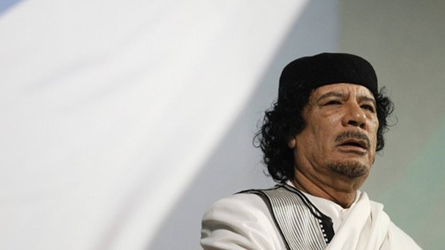 FILE: Libyan leader Muammar al-Qaddafi gives a speech in Rome August 30, 2010.
