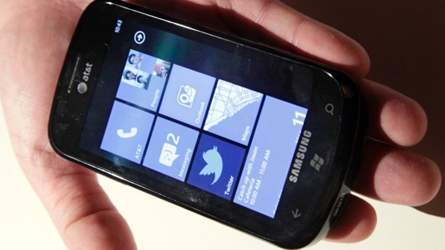 The Windows Phone 7 powered Samsung Focus at the launch of new smart phones with AT&T Inc. ahead of the holiday shopping season, that will run on Microsoft's new mobile software, in New York,  Monday, Oct. 11, 2010. (AP Photo/Richard Drew)