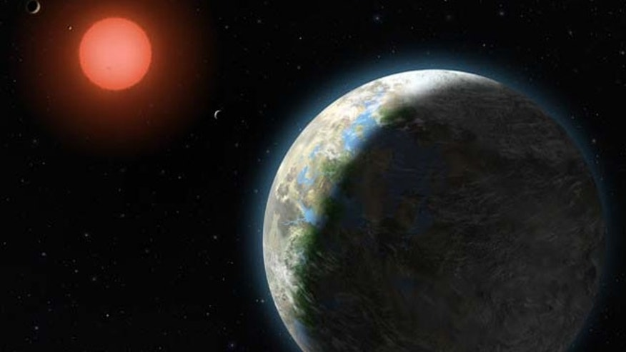 This artist's conception shows newly discovered planet Gliese 581g, which has a 37-day orbit right in the middle of the star's habitable zone. The Gliese 581 system and its host red dwarf star is only 20 light years from Earth.