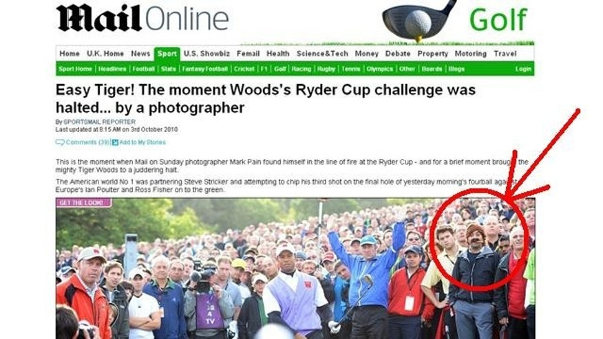 The photo that started it all. Cigar Guy, circled in the back right corner, watched Tiger Woods hit a ball straight at a photographer. Then his odd appearance upstaged the stunning photo.