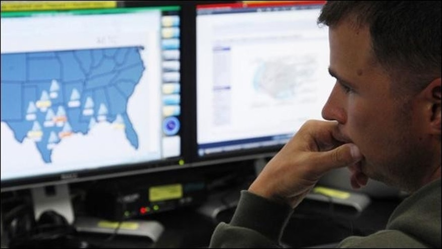 July 20, 2010: Josh Mayeux, network defender, works at the Air Force Space Command Network Operations & Security Center at Peterson Air Force Base in Colorado Springs, Colorado.