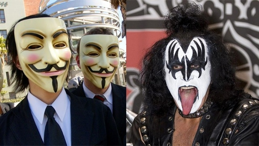 Gene Simmons (seen at right) has been targeted by vigilante hackers from 4chan. Members of the group, which calls itself Anonymous, are seen at left in a protest against the Church of Scientology.