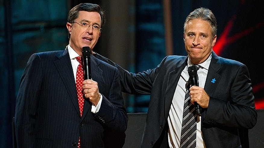 In this Oct. 2, 2010 file photo, Stephen Colbert, left, and Jon Stewart appear on stage at Comedy Central's 'Night Of Too Many Stars: An Overbooked Concert For Autism Education' at the Beacon Theatre in New York.