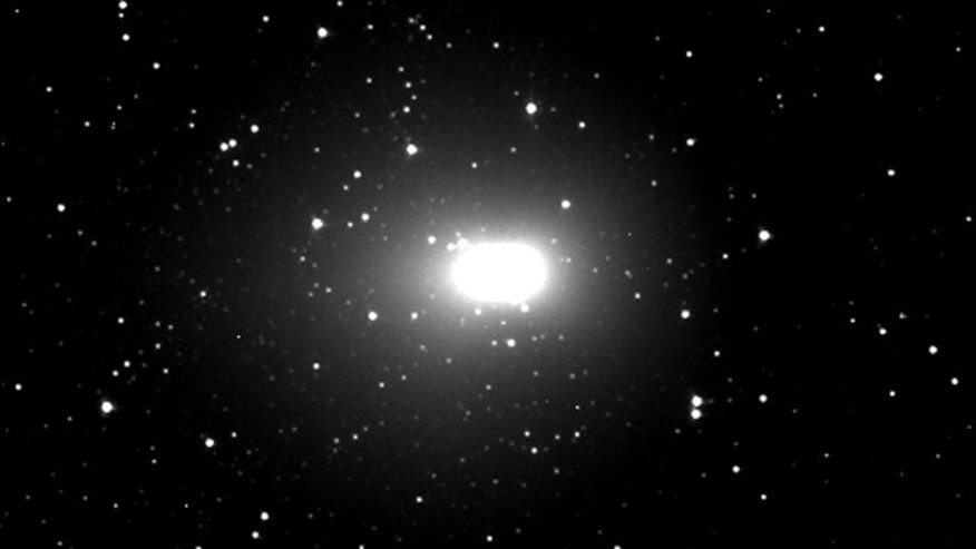 NASA's Deep Impact probe took this image of comet Hartley 2 on Nov. 2, 2010, from a distance of 2.3 million kilometers (1.4 million miles). The white blob and the halo around it are the comet's outer cloud of gas and dust, called a coma. New pictures are expected Thursday morning.