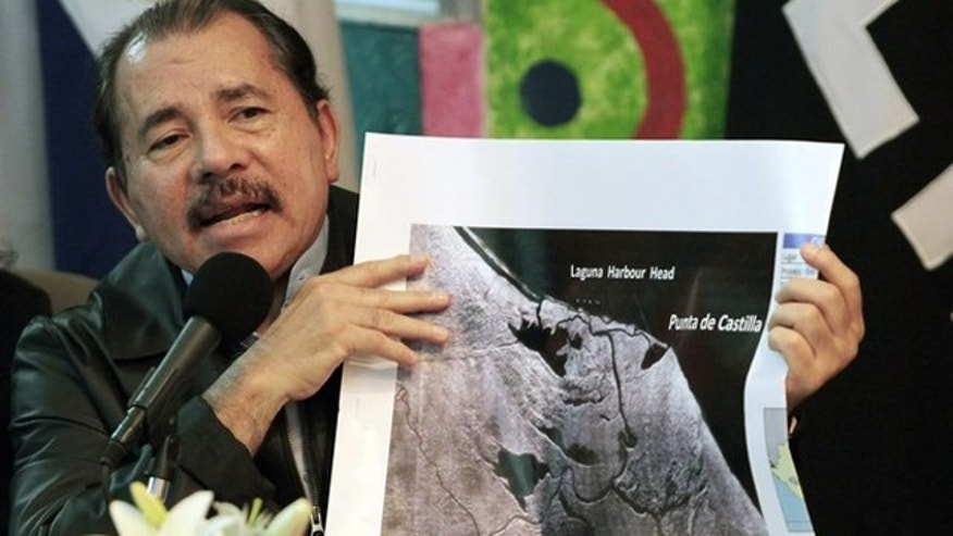 Nicaragua's President Daniel Ortega shows a map referring to the territorial dispute with Costa Rica during an address to the nation in Managua November 13, 2010. The Organization of American States urged Nicaragua and Costa Rica on Saturday to withdraw their security forces from a disputed river border in a spat that forced Google to correct its maps of the area.