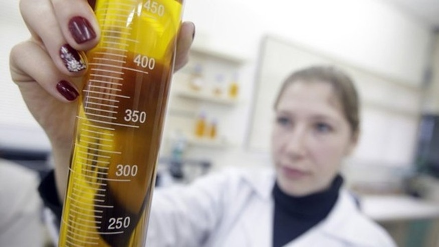 A chemical engineer holds up a test-tube of biofuel at the Oleoplan factory in Brazil.