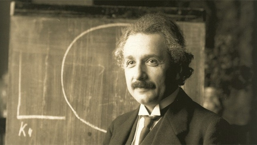 A young Albert Einstein lectures in Vienna in 1921.