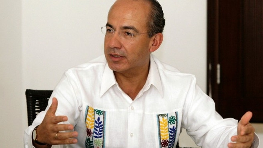 Mexico's President Felipe Calderon speaks during an interview with The Associated Press in Cancun, Mexico, Monday Nov. 29, 2010. Calderon is in Cancun to attend the United Nations Climate Change Conference, the first full U.N. meeting since the letdown last December of the Copenhagen summit.