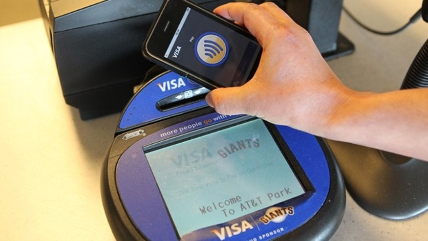 Technology manufacturers and credit card companies are pushing for new standards for mobile payments -- relying on just a wave of your cell phone.