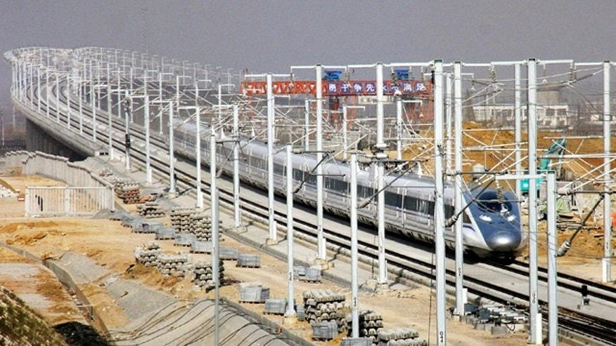 A CRH high-speed train zips in a test run in Zaozhuang, in east China's Shandong province, Friday, Dec. 3, 2010. The Chinese passenger train hit a record speed of 302 miles per hour (486 kilometers per hour) Friday during a test run of a yet-to-be opened link between Beijing and Shanghai, state media said.