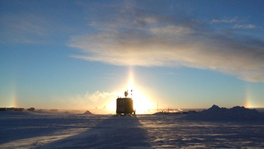 A silhouette of the IceCube neutrino detector facility at Amundsen-Scott South Pole Station.