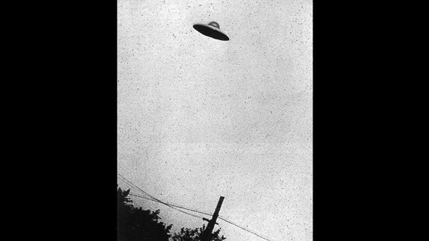 This grainy black and white image purports to show a UFO hovering over Passoria, New Jersey, in July, 1952.