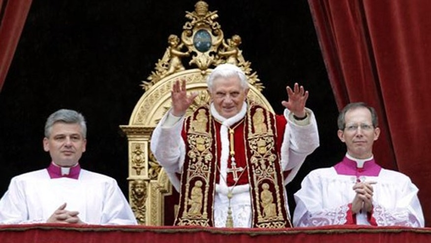 Dec 25: Pope Benedict XVI blesses the faithful during the Urbi et Orbi (to the City and to the World) message in St. Peter's square at the Vatican.