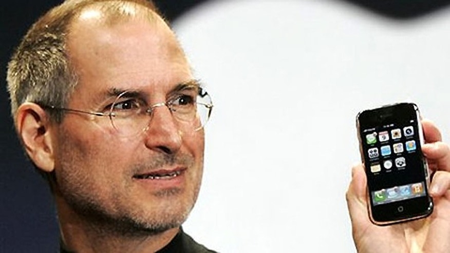 A new era dawns: Steve Jobs unveils the first iPhone in January 2007.