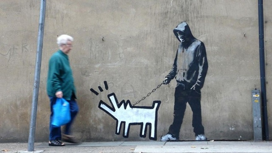 A screen capture of the website of street artist Banksy reveals one of the graffitti artists many outdoor works.