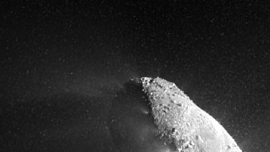 A high-resolution camera on NASA's EPOXI spacecraft captured stunning images of part of the nucleus of comet Hartley 2. The sun is illuminating the nucleus from the right, and a distinct cloud of individual particles is visible. This image was obtained on Nov. 4, 2010, the day the EPOXI mission spacecraft made its closest approach to the comet.