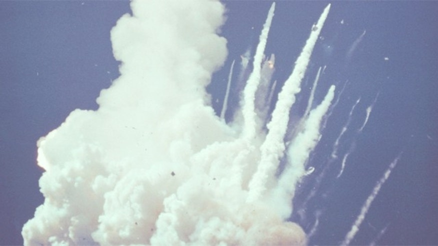 At 78 seconds after liftoff, this image shows Challenger's left wing, main engines (still burning residual propellant) and the forward fuselage (crew cabin).