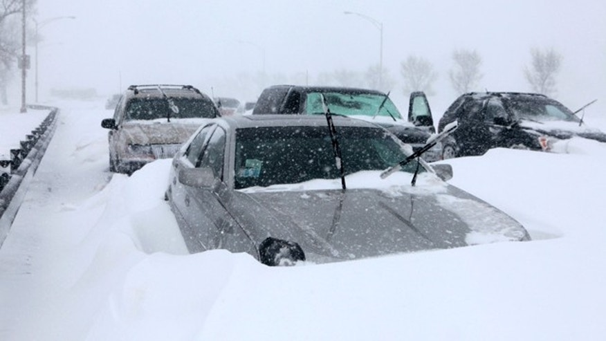 Hundreds of cars were stranded on Lake Shore Drive in Chicago, Wednesday, Feb. 2, after a winter blizzard of historic proportions wobbled the otherwise snow-tough city.
