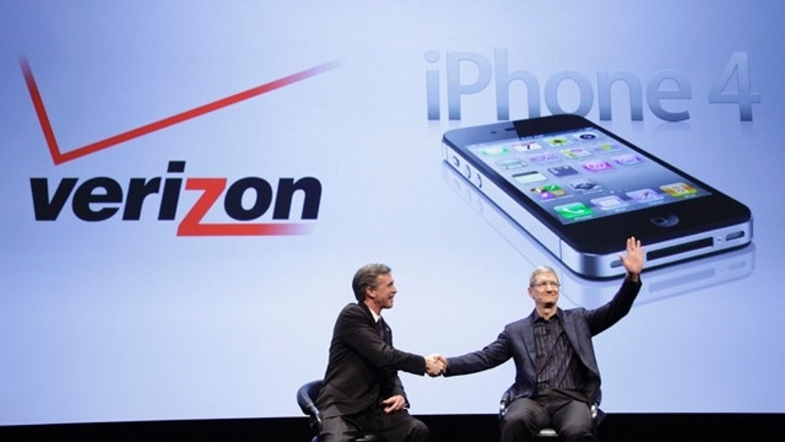 Dan Mead, left, CEO of Verizon Wireless, and Tim Cook, COO of Apple, announce that Verizon Wireless will carry Apple's iPhone, Tuesday, Jan. 11, 2011 in New York.