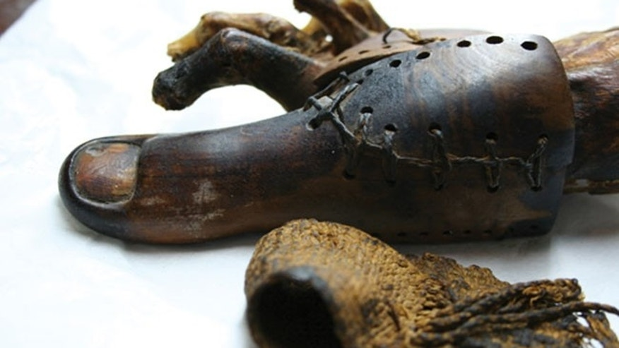 An ancient Egyptian false toe found on a female mummy buried near Luxor The strapping in the foreground bound it onto her foot.