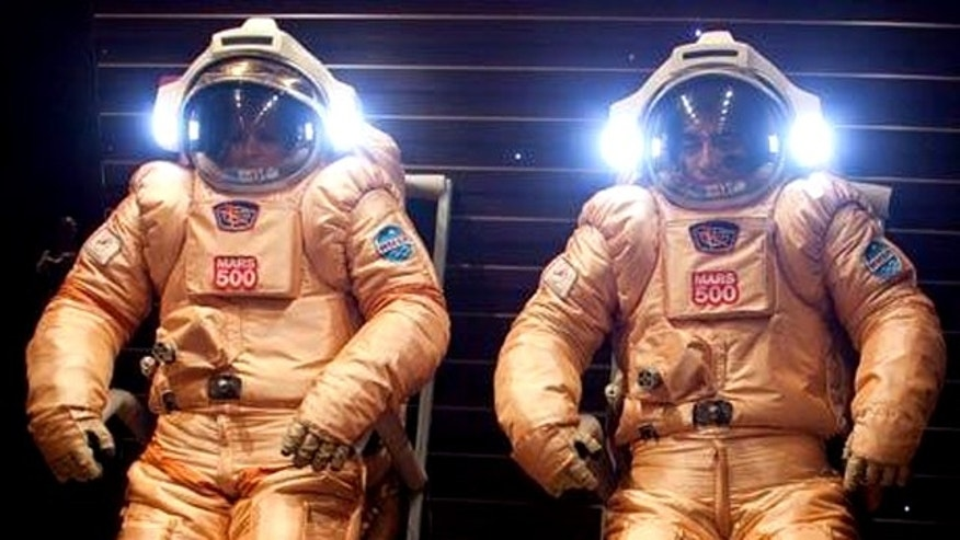 Mars500 crewmembers testing their spacesuits out before a simulated journey to the Martian surface.