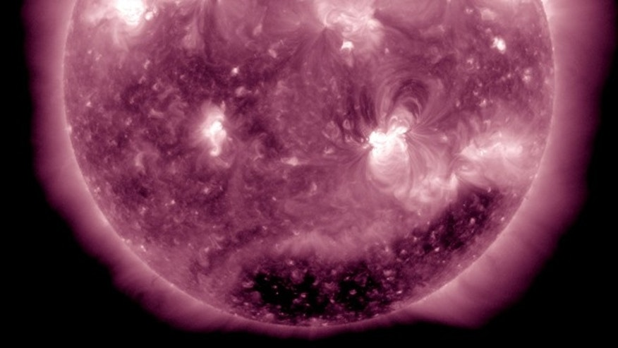 An X2.2 flare erupted from the sun's active region 1158 (at lower right) at about 0150 UT or 8:50 pm ET on February 14.