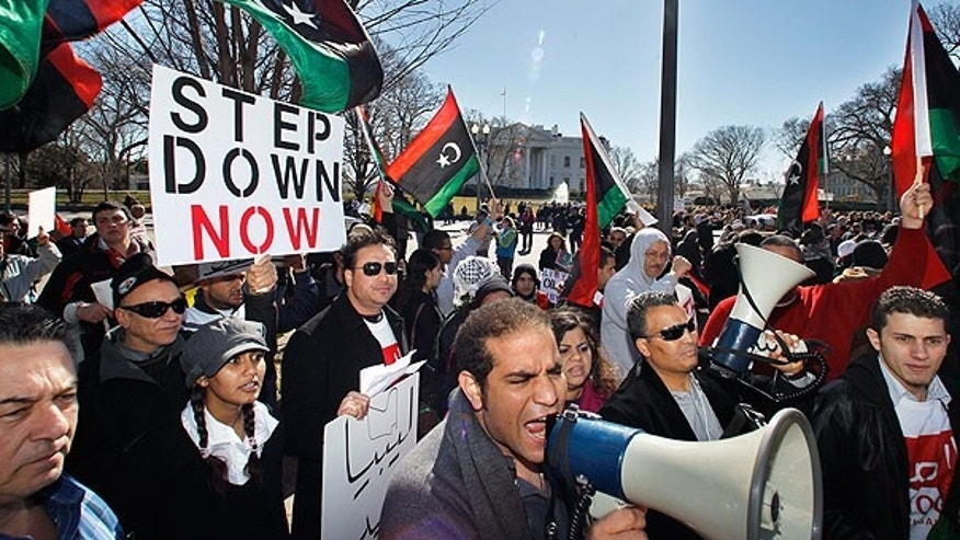 Feb. 19: Protesters demand the ouster of Libyan leader Qaddafi in front of the White House in Washington.