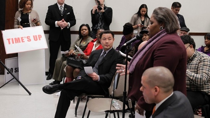 New York City Comptroller John Liu, center, listens while participants in a public meeting suggest audits for his office in New York. New York and cities around the country are trying to follow the example of private companies and use technology and the Internet to harness the wisdom of citizens and create virtual civic forums.