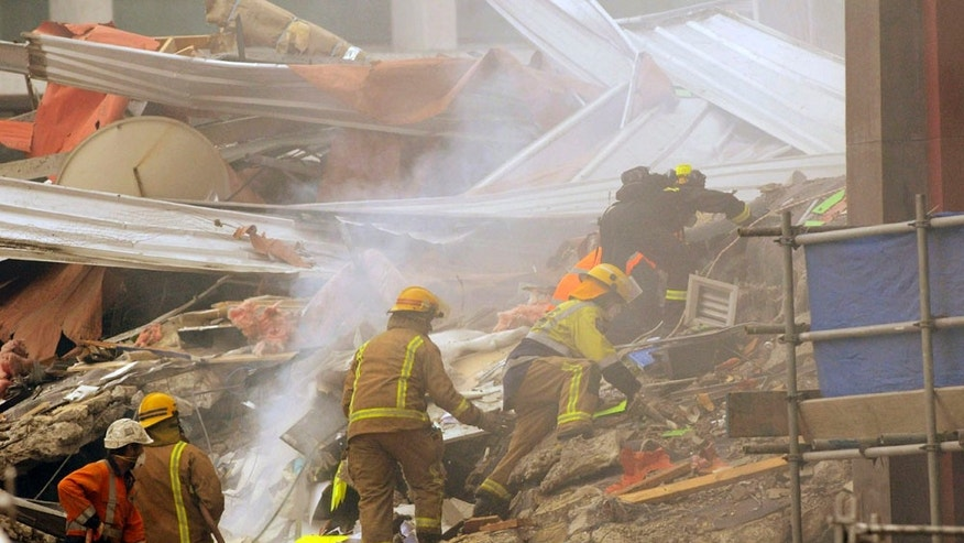 Feb. 22: Rescue workers sift through the debris of a collapsed building after an earthquake rocked Christchurch, New Zealand.