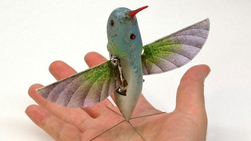 A robot hummingbird demonstrates precision hovering and independent. The two-wing, flapping aircraft carries its own energy source, and uses only the flapping wings for propulsion and control.