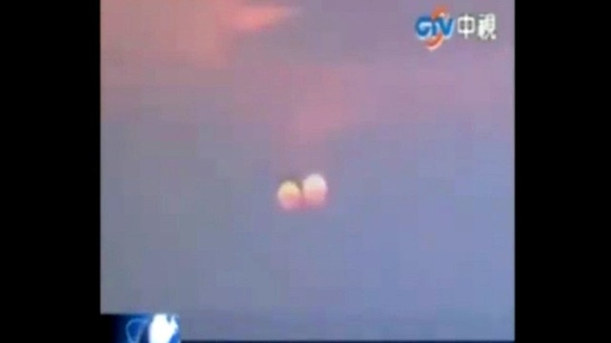 """A still from a video that purportedly shows a """"two suns"""" setting in China. One scientists suspects the apparition could be an optical illusion at sunsets, rather than an all-out hoax."""