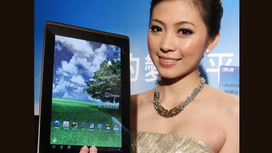 March 25, 2011: A Taiwanese model displays an Asus Eee Pad Transformer during its new product media event in Taipei, Taiwan. The Asus Eee Pad Transformer features a 10.1-inch touch screen, tablet with a detachable keyboard dock.