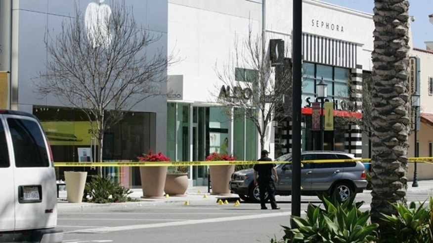 April 4, 2011: Police block off an area by the Apple Store at the Otay Ranch Town Center in Chula Vista, Calif.