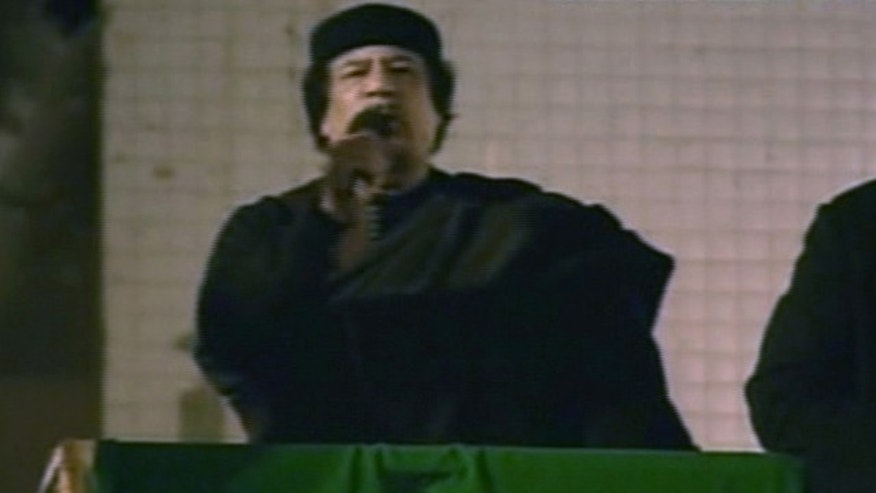 March 22: This image taken from Libyan State TV shows Libyan leader Muammar al-Qaddafi as he talks to a large crowd in Bab El Azizia, Libya.
