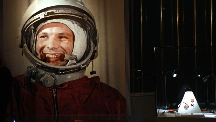 An undated portrait of the first man in space, Yuri Gagarin, and his award of the Hero of the Soviet Union, at right, part of an exhibition dedicated to the 50th anniversary of the first man in space.