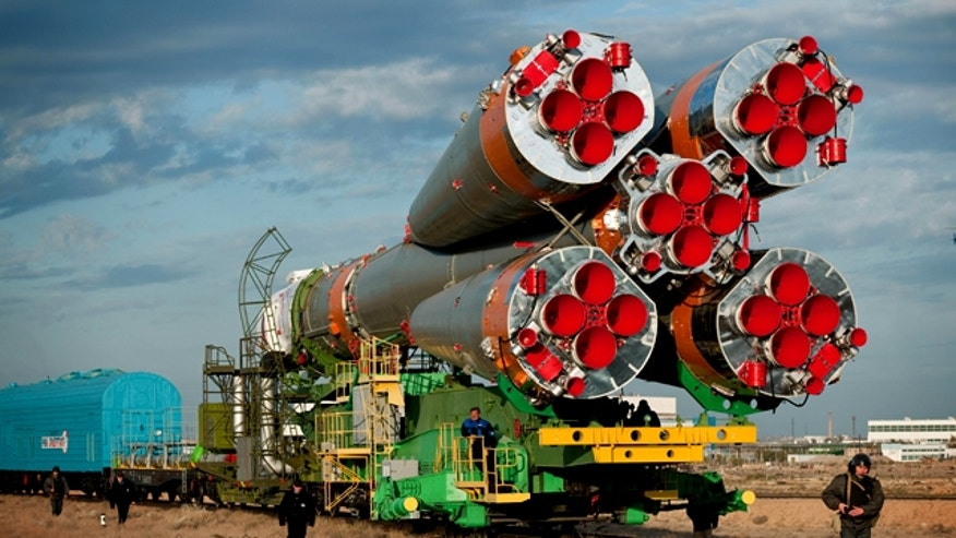 A Soyuz spacecraft is rolled out by train to the launch pad at the Baikonur Cosmodrome, Kazakhstan, on Oct. 5, 2010.