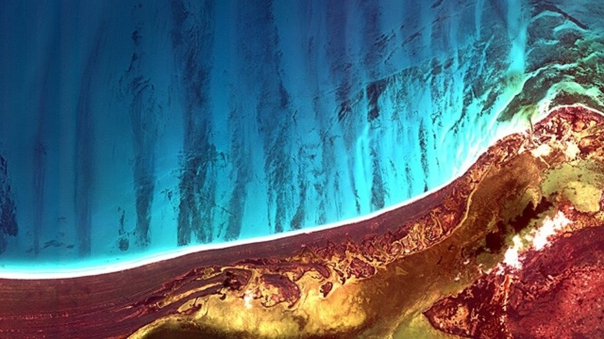 Holbox Island and the Yalahau Lagoon on the northeast corner of Mexicos Yucatan Peninsula are featured in this image, acquired by the Korea Multi-purpose Satellite (Kompsat-2) of the Korea Aerospace Research Institute (KARI).