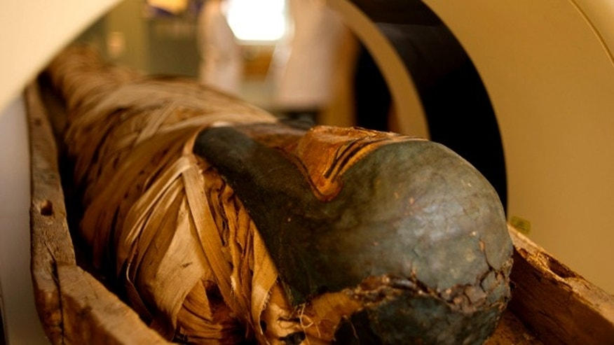 Nov. 9, 2010: A mummy is seen before a CT scan at Fletcher Allen Health Care, the teaching hospital at the University of Vermont, in Burlington, Vt. The University's CT scans helped doctors create a full-sized, three-dimensional model of the mummy's skull -- and solve some modern crimes.