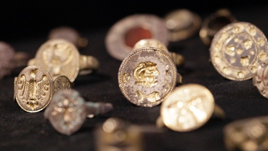 May 2, 2011: A trove of medieval jewelry and other precious objects found by a man working in his backyard includes pieces made for a royal court and may be worth as much as 100,000 euros ($150,000) government experts said Monday.