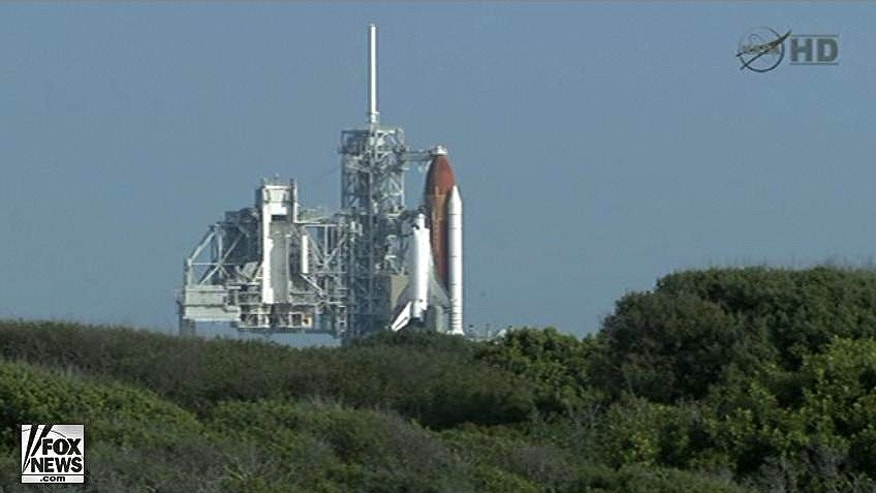 Space shuttle Endeavour sits on the launchpad awaiting blast-off on its final mission, STS-134.