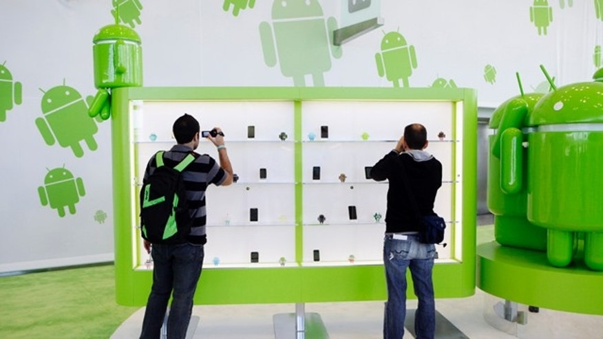 May 11, 2011: Attendees take a closer look at smart phones and tablets running on the Android software at the Google IO Developers Conference in San Francisco.
