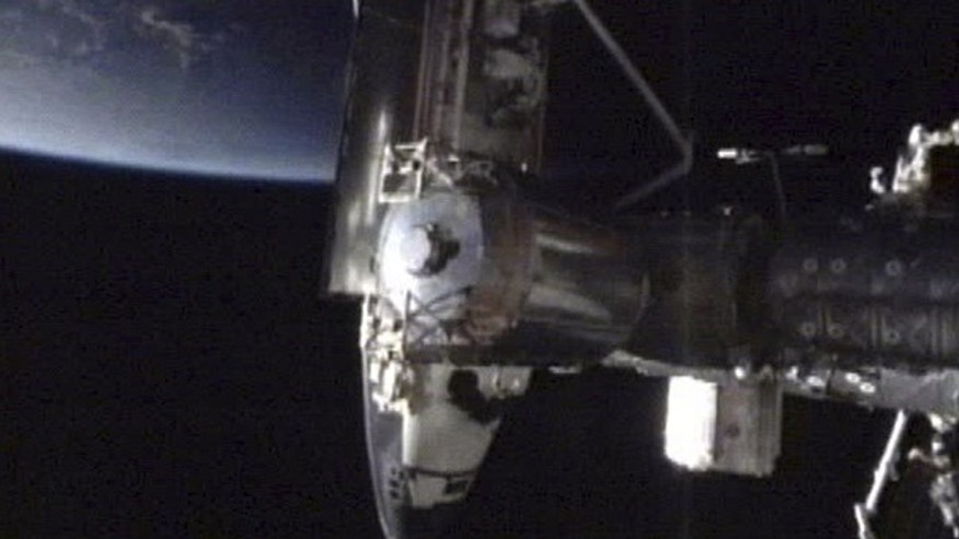 May 18: A photo made from NASA video shows the Endeavour docked on the Harmony node of the International Space Station on the penultimate voyage of the space shuttle program.