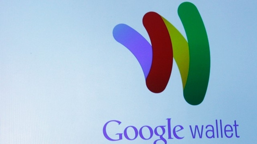 "The Google Wallet logo is on display during a news conference, Thursday, May 26, 2011, in New York.  Google wants the smartphone to be the wallet of the future, a container for digital credit cards, coupons, receipts and loyalty cards that can be ""tapped"" to terminals in stores."