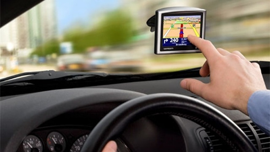 A windshield-mounted GPS helps a driver navigate.