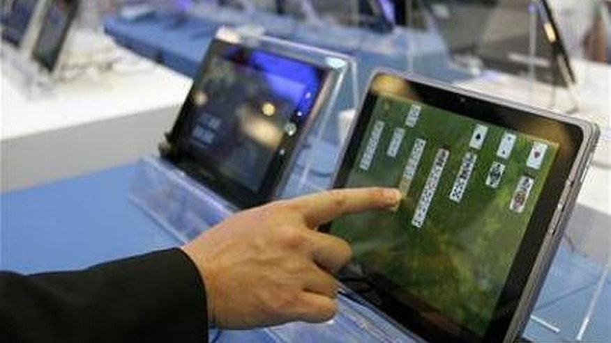 May 31, 2011: A visitor plays with a tablet PC at the Intel booth during the Computex 2011 computer fair at the TWTC Nangang exhibition hall in Taipei.