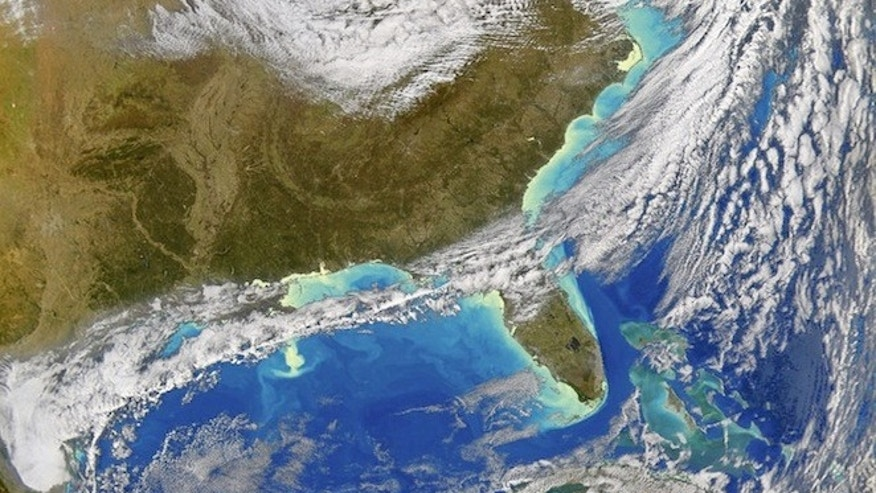 A dark green plume of plankton extends from the Mississippi River delta into the Gulf of Mexico in December 2004. This bloom may have been caused by heavy rains that triggered flooding across the Southeast and carried extra nutrients into the Gulf of Mexico. When large blooms die, their decomposition can deprive the water of oxygen, creating dead zones.