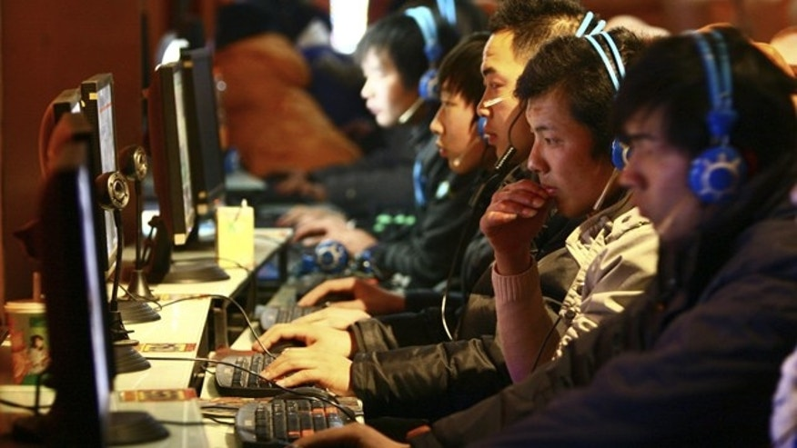 Chinese Web surfers browse the Internet in a local cybercafe.