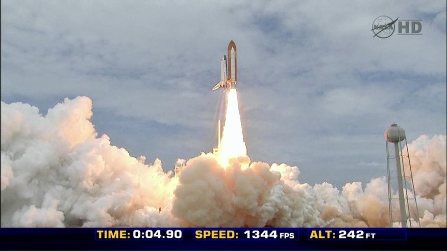 Up, up and away! Space shuttle Atlantis rocketts into space.